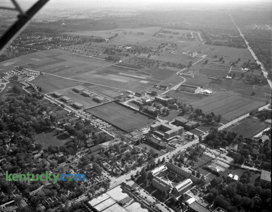 1954 aerial view of the University of Kentucky campus, centered on a men's dormitory, to be named Donovan Hall, being built, center right, facing Rose Lane. It was completed in 1955 and named to honor the service of Herman L. Donovan, president of the University at that time. A livestock exhibition building is also in the process of being built, above and to the right of the dorm. This view of south campus precedes the building of the Medical Center, which would later sit where the open field is farther out Rose Lane closer to the intersection with South Limestone Street, seen at top right. In the upper middle of the image on the farmland is the future site of Commonwealth Satdium and the heavily treed area in the left of the image is now the site of the W.T. Young Library. Published in the Lexington Leader October 6, 1954.  Herald-Leader Archive Photo