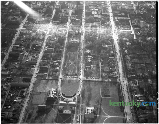 """Aerial view of area of downtown Lexington around Gratz Park, center, in February 1951. Old Morrison on Transylvania's campus is seen, bottom center. The Lexington Leader published the photo to illustrate a story about a proposed """"downtown distributor"""" street that was being advocated in a major street plan to be presented to the city-county planning and zoning commission. This part of the route was to start at Limestone, on the left, and would've gone just beyond Broadway. It was to bisect historic Gratz Park. Residents of the park were expected to present their objections to the new street at a meeting of the zoning commission Thursday March 1. The """"distributor """" was proposed to facilitate movement of traffic to the downtown area from residential sections of Lexington. The proposed route was to run from Forest Avenue to Georgetown Street.   Herald-Leader Archive Photo"""