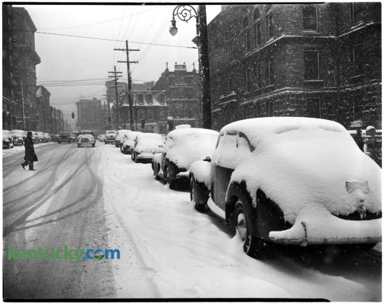 A pedestrian crossed Short Street behind the Fayette County Courthouse during a Dec. 5, 1945 snow storm. Four and one-half inches fell on Lexington, with some parts of the county reporting  seven inches. Fayette County schools were closed the following day, but city schools were open. Herald-Leader Archive Photo