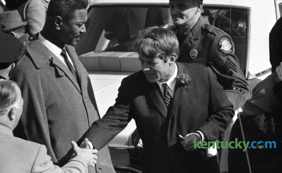 Sen. Robert F. Kennedy, center, shook hands with Governor A.B. Happy Chandler after arriving at Lexington's Blue Grass Field, Feb 13, 1968, before beginning a two-day tour of poverty areas in Eastern Kentucky. At left is Harry Sikes, Lexington's first black city commissioner. Lexington's Red Mile Place, off Versailles Road, was recently renamed to Harry Sykes Way in honor of the former mayor pro tem and vice mayor. Click here to see an image of Sykes being sworn in as a city commissioner. Herald-Leader Archive Photo