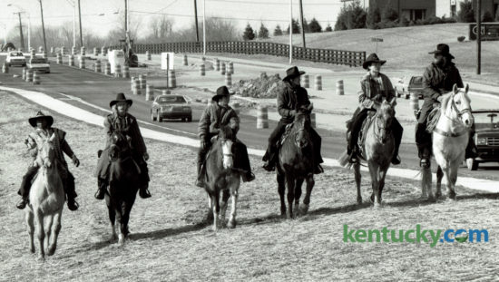 Six riders on horseback started out from Humana Hospital on a 1450 mile ride across Kentucky to raise money for the Kentucky Diabetes Foundation Patient Assistance Program on February 24, 1988. The riders, from left, Kenneth Carter, Ray Crowe, David Napier, Allen Reynolds, Dennis Adams and Billy Adams, rode along Man O'War Blvd toward Winchester Road. Photo by John C. Wyatt | Staff