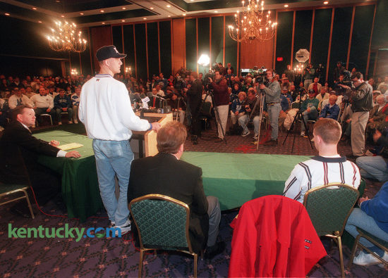 "High school football standout Tim Couch announced his intentions to sign a letter-of-intent to play football at the University of Kentucky, Dec. 24, 1995. About 200 fans attended the news conference in a ballroom at the downtown Lexington Radisson Hotel, ninety minutes before the tip-off the annual Kentucky-Louisville basketball game across the street at Rupp Arena. ""I came up to watch the basketball game, but I would have come up just to see this,"" said fan Eddie Evans, 49, of Corbin. After considering Auburn, Florida, Florida State, Notre Dame, Penn State and Ohio State, among others, Couch narrowed his list to UK and Tennessee. The Tennessee spin was that Couch could play a year behind star Vols quarterback Peyton Manning, then step in as a starter in 1997 when Manning turned pro. ""I didn't want to just be another name in a great line of quarterbacks at a school, I wanted to start my own name here at Kentucky and hopefully get a big tradition started here,"" Couch said. Rated the nation's best quarterback prospect by most recruiting services, and possibly the best Kentucky football prospect since Paul Hornung left Louisville Flaget for Notre Dame in the 1950s, Couch threw for a national record 12,104 yards and 133 touchdowns over his four years. During his senior year, the 6-foot-5, 215-pounder threw for 3,916 yards and 42 touchdowns, leading Leslie County to 12-2 record. He was named Gatorade's national high school player of the year. ""This is the best day of my life,"" said Tim's father, Elbert. ""This is where we wanted him to go all along."" Photo by Mark Cornelison 
