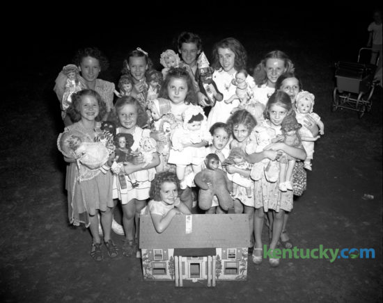 A group of the first-place winners in the Castlewood section of the city-wide doll show August 8, 1947, were shown with their prize-winning prettiest, ugliest, biggest, smallest or otherwise dolls.  Shown with her doll house is Mary Ann Hubbuch; first row, left to right,  Margaret Marie Sweeney, Elizabeth Gayle Mount, Phyllis Jean Pridemore, Patsy Jo Garrison, Jo Ann Cox and Juanita Garrison; second row, Sally Ann Carlin, Mary Anne Davidson, Eudean Bowling, Mary Ann Graves, Pauline Garrison and Glenna Davidson. Published in the Lexington Herald-Leader August 10, 1947. Herald-Leader Archive Photo
