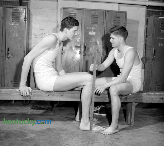 University of Kentucky basketball sophomores, Bill Spivey, left, and Bobby Watson compare the lengths of their legs in the locker room in March 1950. Watson was the shortest member of the squad measuring at 5-foot-10 inches, while  Spivey was the tallest at 7 feet. The top of Spivey's knee to floor was 26 and a half inches, while Watson's was 21 and a half. Spivey, UK's first 7-foot-tall player, had dreams of playing for the National Basketball Association, but those dreams were dashed after he was implicated in a point-shaving scandal in the early 1950s. Click here to see more images from our archives of Spivey. Watson the fifth 1,000-point career scorer in UK basketball history, died Tuesday. Published in the March 2, 1950 Lexington Leader. Herald-Leader archive photo