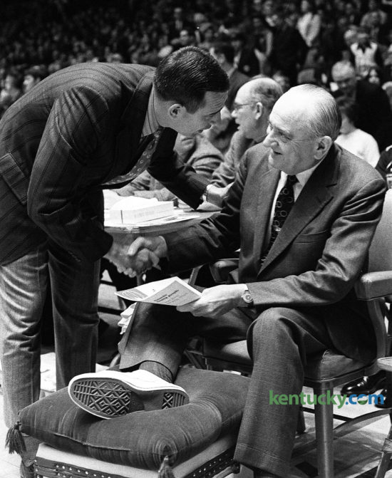 University of Kentucky basketball coach Adolph Rupp is greeted by Alabama coach and former Wildcat player C.M. Newton, Feb. 22, 1971 at Memorial Coliseum. Rupp, 69, was sidelined for the game with a foot infection complicated by by diabetes. He had been hospitalized at the UK Medical Center since Feb. 8, but commuted to UK home games and some practices. Rupp missed three games, viewed three other ones as a spectator and even made a road trip to Vanderbilt. Assistant coach Joe B. Hall was named active coach during Rupp's absence. Newton was a member of UK's 1951 national championship team under Rupp. Newton coached at Lexington's Transylvania University for 12 years before being named coach at Alabama, a job he got in part because of a recommendation by Rupp. Newton went on to lead the Tide to three straight SEC titles. After a 30-year coaching career, he came back to Lexington in 1989 to be the athletic director at his alma mater, UK, where he served for 11 years. Herald-Leader staff file photo