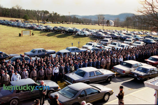 """About 700 law officers from Kentucky, Ohio and Indiana attend the funerals for Powell County Sheriff Steve Bennett and Arthur Briscoe, his deputy and brother-in-law, Feb. 2, 1992 in Stanton. The two were shot and killed three days earlier after Briscoe tried to serve a warrant on Ralph Baze Jr. for officials in Toledo, Ohio. Baze opened fire on them with a SKS assault rifle, then took their guns and fled into the hills. """"The sheriff's car is riddled with bullets,"""" said Ed Robinson, a spokesman for the Richmond state police post. Baze gave himself up eight hours later by calling a 911 emergency number from near Ravenna about 10 miles away in Estill County. He said he had been shot and asked police to come get him. The shootings left the county with one full-time deputy, Judge-Executive Forest Meadows said. Three days later mourners filled the Powell County High School gymnasium for the afternoon service. Almost 700 officers in uniforms of brown, blue, gray and green filed in, filling the home-side bleachers. The procession to the cemetery stretched more than a mile. Baze was convicted and sentenced to die. He was scheduled for execution in 2007 but was issued a stay after he sued on the grounds that execution by lethal injection using the """"cocktail"""" prescribed by Kentucky law constitutes cruel and unusual punishment. The United States Supreme Court rejected that claim in 2008. He later challenged Kentucky's clemency system but lost his appeal in 2015. He is incarcerated on death row in Kentucky State Penitentiary in Eddyville. Photo by Frank Anderson 