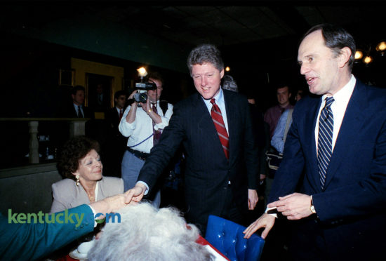 """Arkansas Gov. Bill Clinton and Kentucky Gov. Brereton Jones greet diners at Flynn's Restaurant and Statesman Lounge in Frankfort, Feb. 4, 1992. Clinton took time out from campaigning in New Hampshire to gather the endorsements of Jones and a host of other top Kentucky Democratic officials. In an impassioned speech to about 300 people crammed into the Capitol Rotunda, Clinton acted as if he already was running against Bush rather than his opponents in the Democratic primary. He never mentioned any of his Democratic opponents by name; U.S. Sens. Tom Harkin of Iowa and Bob Kerrey of Nebraska, former U.S. Sen. Paul Tsongas of Massachusetts and former California Gov. Jerry Brown. Clinton said Bush and the Republicans have been sending the wrong message to the nation: """"Turn a quick buck, get it while you can and walk away with the money."""" This attitude has helped produce severe economic problems that Bush does not understand, Clinton said. Later, at a news conference outside Flynn's restaurant, reporters did not ask Clinton the kinds of questions about marital fidelity that made national news the week prior. Instead, most of the questions dealt mainly with details of his economic and educational proposals. Jones' endorsement was important because it could influence the state's 61 delegates to the Democratic presidential nominating convention. Clinton returned to New Hampshire that night, which held the first Democratic primary two weeks later, which he won, catapulting his successful bid to the White House that November. Jennifer Podis 