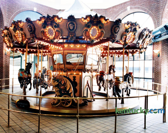 """The carousel in Festival Market, now called Triangle Square, July 25, 1994, three days after it and the building was sold at auction. The 22-foot-wide, 12-horse carousel was bought by politician and Lexington caterer Jerry Lundergan for $35,000. He tried to sell it to the Lexington Children's Museum for the same price he paid for it. Mayor Pam Miller said the city had considered buying the carousel for the museum but they didn't have the money to buy it or someone to run it and """"there is no extra space in the Children's Museum,"""" she said. Lundergan eventually sold the carousel to Tom's Farms, a produce and amusement complex in Corona, Calif. It is still in use there today. """"It's a beautiful piece of equipment,"""" Lundergan said after the auction for the carousel, which was built in San Francisco in 1986. """"It was the showpiece of Festival Market."""" The carousel was always popular and added to the vibrancy of the mall, said Dudley Webb, partner with the Webb Cos. which developed the downtown Lexington shopping center. The $16 million, three-story mall opened in 1986 as Lexington Festival Market, designed as an upscale center with dozens of shops and restaurants. While children rode the merry-go-round on the top floor, a jazz pianist played lunchtimes in the courtyard below. However, the mall, which was expected to have up to 70 businesses, never found its niche and has lost money each year since it opened. At the time of the auction, the it was in the midst of converting from an upscale center to a factory outlet mall. Developed by the Webb Companies in partnership with Kentucky Central Life Insurance Co., the mall became a casualty of the failure of Kentucky Central. When the insurance company failed in 1993, the mall was placed in receivership. The estimated debt of the mall was more than $13 million, according to court records. The Webbs had managed the mall since it opened but gave up, citing frustration over efforts to revitalize it. A judge's order dissolved the pa"""