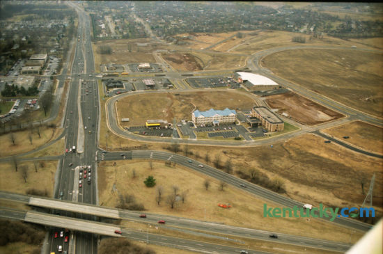 Aerial photo of Beaumont Centre under construction on February 20, 1996. New Circle Road is seen running left to right at the bottom of the photo and intersects with Harrodsburg Road at lower left.