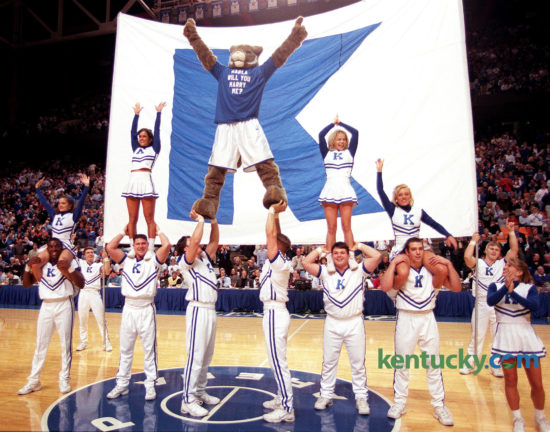 """Later Duerson proposed to his girlfriend, Karla Sodan, in grand style. With 7:53 left in the second half of UK's victory over South Carolina, Duerson, in full costume, climbed to the top of a cheerleaders' pyramid wearing a shirt that said: """"KARLA WILL YOU MARRY ME?"""" Photo by Janet Worne 